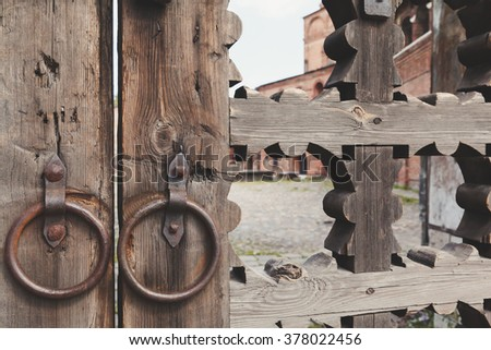 old wooden lattice on the gates in a monastery Russia - stock photo
