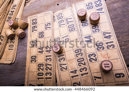 old wooden lotto barrels and game cards - stock photo