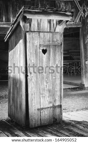 old wooden outhouse at a farm - stock photo