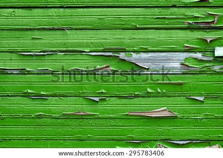 Old wooden painted light green textured background with peeling paint  - stock photo