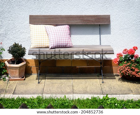 old wooden park bench and cushions