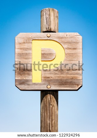 old wooden parking sign - stock photo