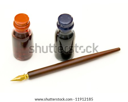 old wooden pen with blue and red ink - stock photo