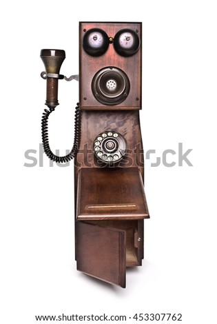 old wooden phone on a white background - stock photo