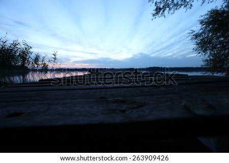 old wooden pier at the lake - stock photo