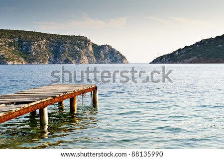 Old wooden pier, beautiful bay