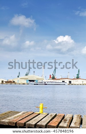Old wooden pier with harbor in distance, Szczecin, Poland. - stock photo