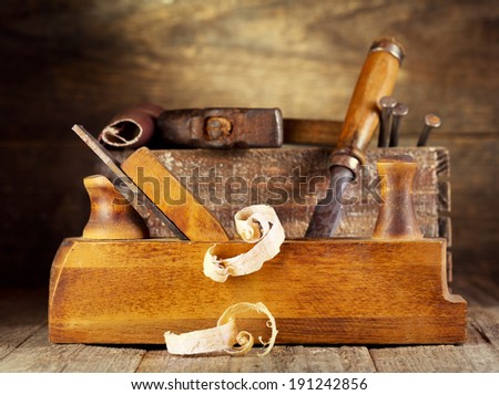 old wooden plane in a workshop - stock photo