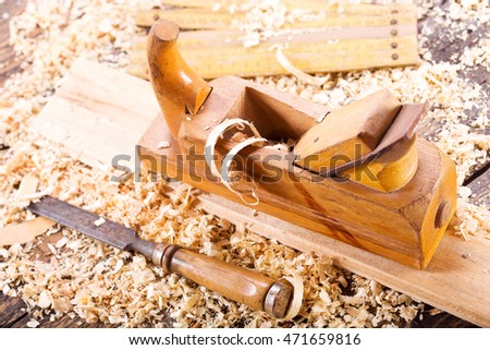 old wooden planer with sawdust in a carpentry workshop