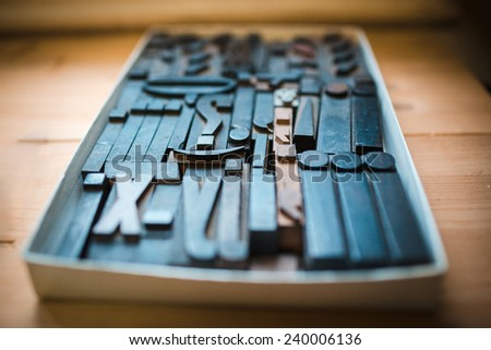 Old wooden printing type, font characters - stock photo