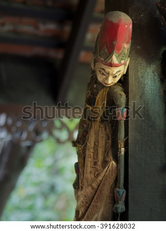 Old Wooden Puppet Shooting in evening