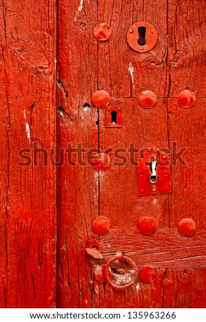 Old wooden red door in Chinchon, Madrid - stock photo