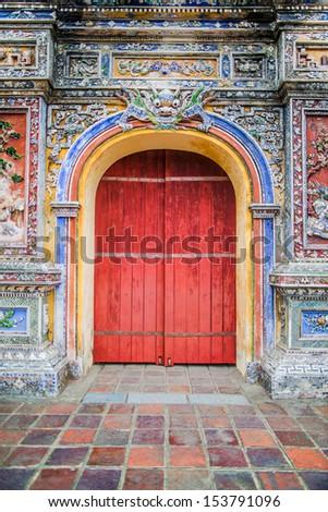 Old wooden red door in Vietnam - stock photo