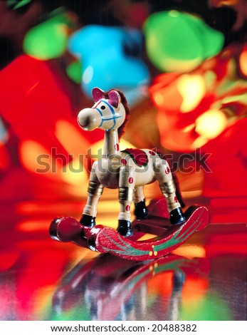 Old wooden rocking horse Christmas ornament - stock photo
