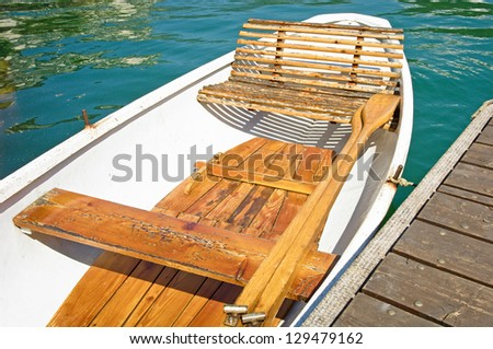 old wooden rowboat at a lake