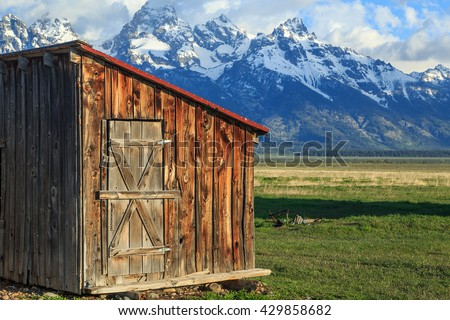 Old wooden shed with the Grand Teton, Wyoming, USA. - stock photo