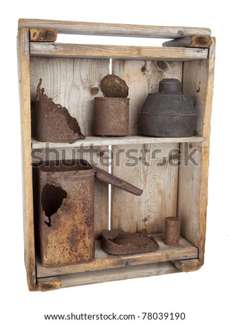 Old wooden shelves with rusty cans on white background