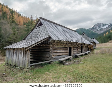 Old wooden shepherd's hut in the pasture at the foot of the High Tatra mountains, Poland  - stock photo