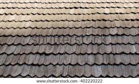 Old wooden shingle facade, detail - stock photo