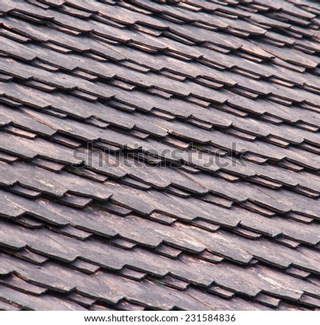 old wooden shingles on the roof - stock photo