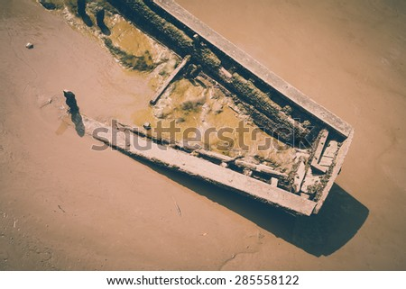 Old wooden shipwreck in Chao Phraya river, Bangkok Thailand - Vintage effect style - stock photo