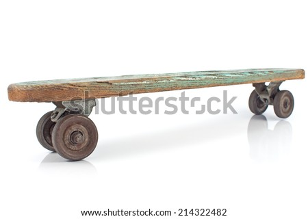 Old wooden skateboard on white background - stock photo