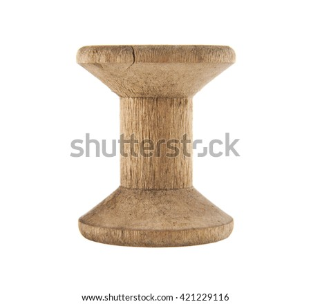 old wooden spool for threads isolated on a white background