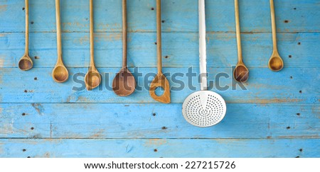 old wooden spoons, and an old skimmer, kitchen utensils cooking concept - stock photo