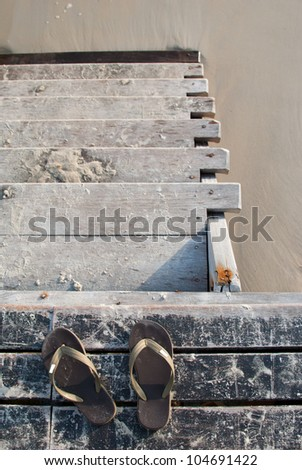 Old wooden staircase leading towards the beach without Slippers - stock photo