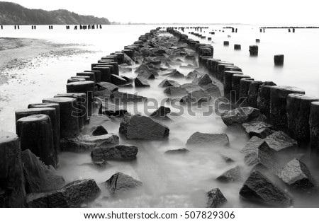 Old wooden stakes barrier with stones, Baltic Sea coast, Gdynia Babie Doly, Poland