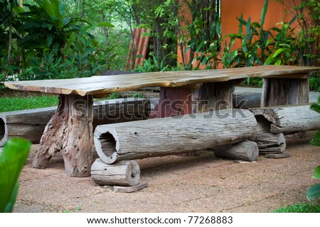 Old wooden table in the garden - stock photo