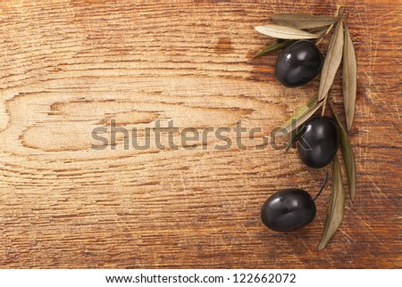 old wooden table, olive branch, background - stock photo