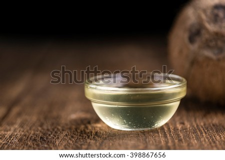 Old wooden table with a portion of Coconut Oil (selective focus) - stock photo