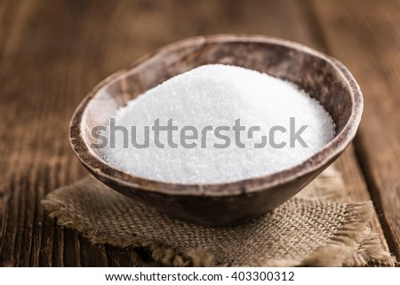 Old wooden table with white Sugar (selective focus; close-up shot) - stock photo
