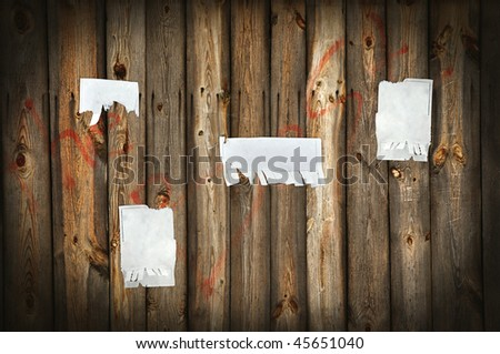 Old wooden taking away with announcements - stock photo
