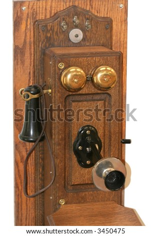 Old wooden telephone on a white background