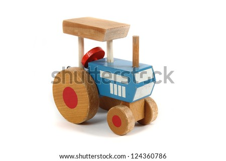 old wooden tractor toy - stock photo