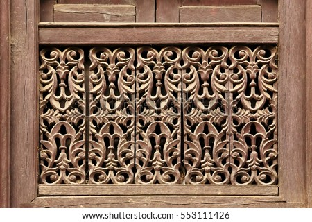 Old wooden traditional Nepalese window detail. Nepal.