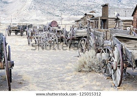 Old Wooden Wagons in a Ghost Town Cody, Wyoming, United States - stock photo