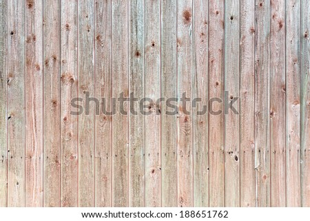 Old wooden wall background in red and green colors, barn in Sweden - stock photo
