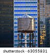 old wooden water tower downtown in New York - stock photo