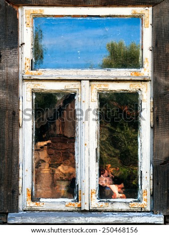 Old wooden white window and reflections - stock photo