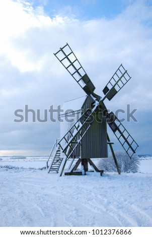 Old wooden windmill in a great landscape at winter season on the swedish island Oland - the island of sun and wind