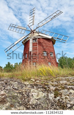 Old wooden windmill in Sweden, painted in traditional red color. - stock photo