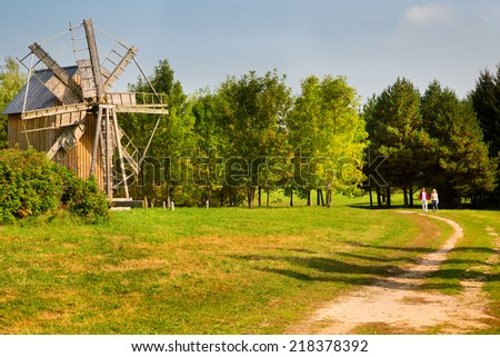 Old wooden windmill near the village Ozertso, Minsk region, Belarus Republic - stock photo