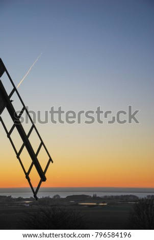 Old wooden windmill wing by sunset at the swedish island Oland in the Baltic Sea