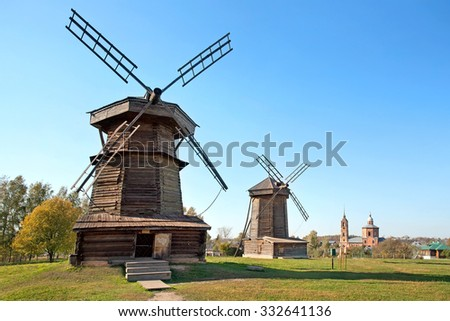Old wooden windmills in Suzdal town, Russia. Golden Ring of Russia - stock photo