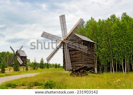 Old wooden windmills in the reserve Malye Korely