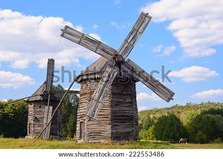 Old wooden windmills on background of blue sky, Kyiv region, Ukraine/Wooden windmills/Old wooden windmills - stock photo