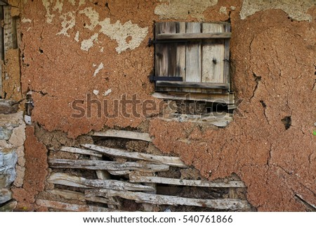 Old wooden window on the house from the ground